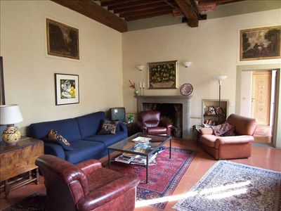 Living room, with working fireplace and original frescoes