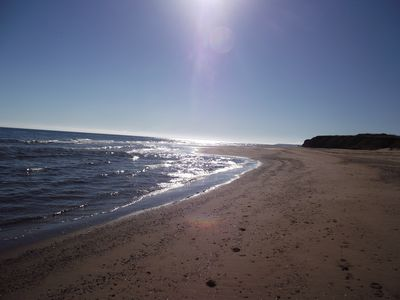 A 5 minute walk down a country road and you are on this beach. Beach chairs incl