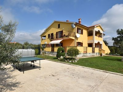 Photo for Spacious and modern apartment in a quiet location with swimming pool and table tennis table