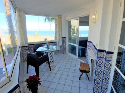 Photo for Cosy apartment on the beach with stunning seaview.