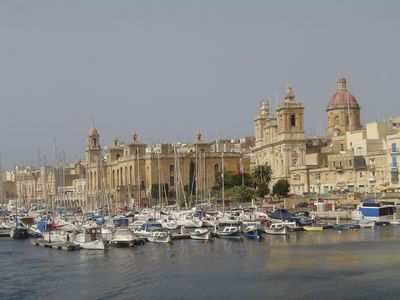 Photo for Seafront apartment with stunning 180 degree historic harbour views