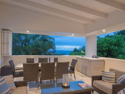 Outdoor dining and sitting area with ocean views