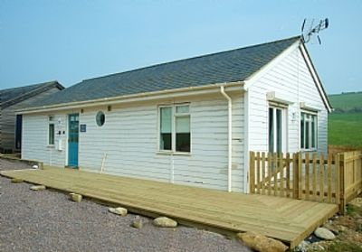 Photo for A Beach Cabin - A Few Steps Away From The Beach in Bridport, Dorset