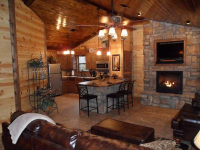 2 Bed/1 Bath, Sleeps 4-6. Open living room with stunning rock and wood accents.