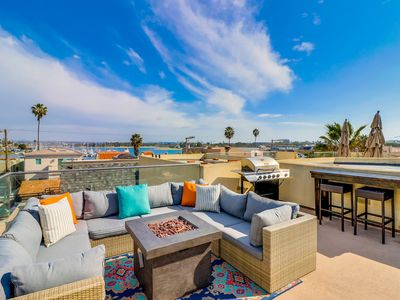 Panoramic rooftop deck with bayside and ocean views.  3 Bedrooms, 3.5 Baths.