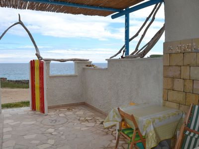 Photo for Cottage Rocabella Directly on the Coast with Air Conditioning & Terrace