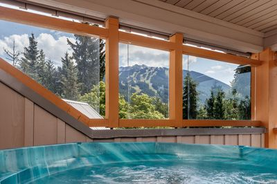 Soak in your private hot tub with a view of both Blackcomb and Whistler mountain