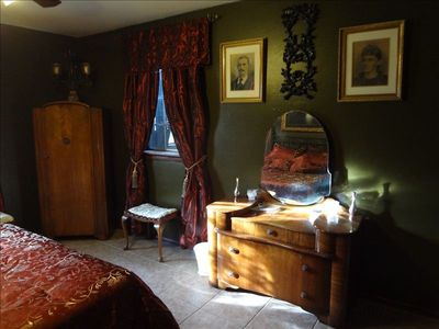 The master bedroom is filled with antiques and interesting local artifacts.