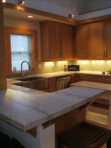Remodeled kitchen with granite counters, and stistainless steel (GE & Bosch)
