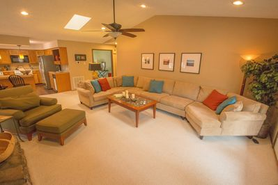 The living area sofa is huge! Plenty of room for your entire group.