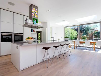 Photo for 20min to Victoria station- Stunning 5 bedroom home with beautiful garden (Veeve)