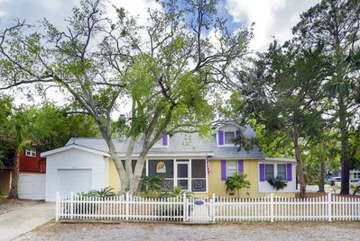 This quaint Tybee Cottage is located on a quiet residential street and features large screened porches and a private pool in a fenced back yard.