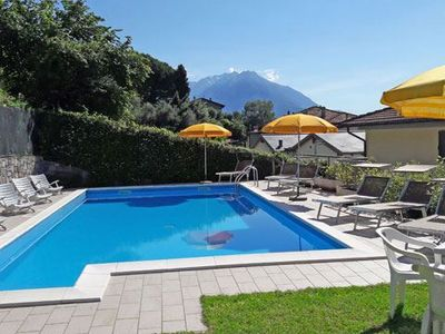 Photo for Apartment Il Bosso 306 with beautiful lake view and large pool. Just 100 meters away from the lake,