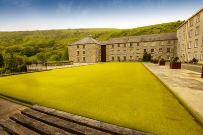 The shared bowling green and the hills of Monsal Dale
