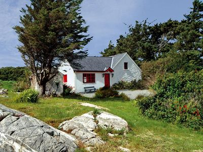 Photo for Traditional, renovated stone cottage, in superb location within typically rugged Connemara cou…