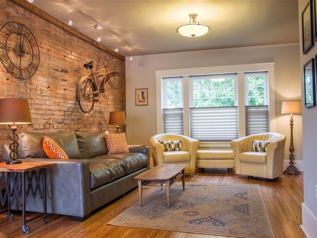 Turn of the century furniture - Living Area With Comfortable Seating And Flat Screen Television