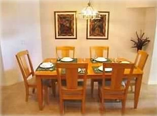 Kitchen seating includes large table for 6 plus 4 bar stools