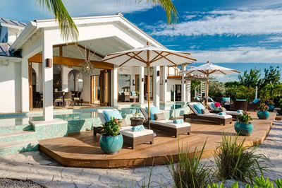Indoor and outdoor living spaces adjoin the 50-foot fresh water heated pool