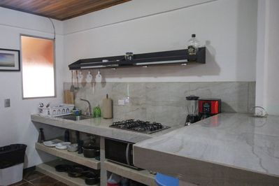 beautiful and clean finishes in the kitchen, coffee maker, blender, microwave