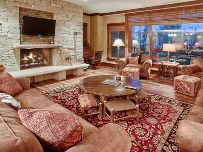 Photo for Luxury ski-in ski-out condo with shared hot tub, beautiful views and heated underground parking