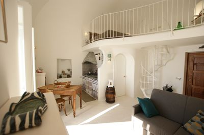 The bright maisonette apartment is divided into a living and a sleeping area.