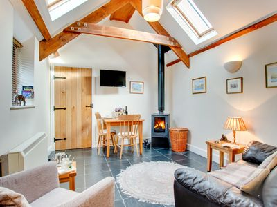 Photo for Romantic cottage with cosy living room, nearby the beach