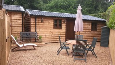 Photo for Chewton Glen West Lodge - New Forest Self Catering Luxury Log Cabin Close to Sea