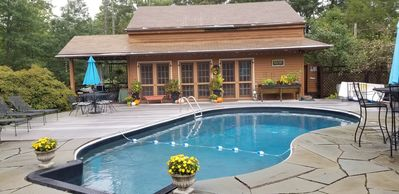 Photo for Unwind & enjoy your private garden setting, outdoor pool, cabana bar & hot tub