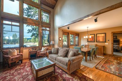 The large picture windows in the living room allow unobstructed views of blue skies and an Old Greenwood fairway