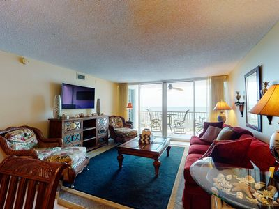 Photo for NEW LISTING! Coastal home with private balcony, shared pool, and beach access!