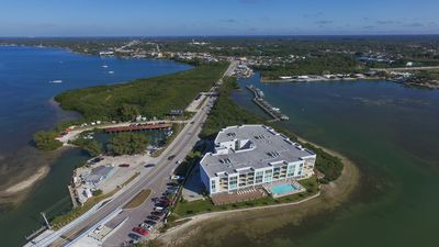 Photo for Stunning Waterfront Penthouse - Walk to Beach