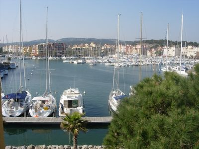 Photo for Gruissan (Aude). Quiet apartment with marina view and parking space