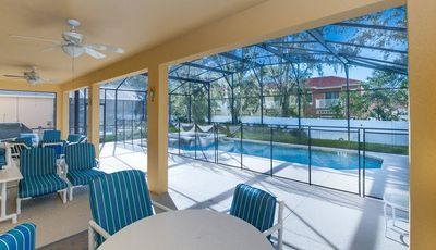 Photo for SEASONS-(1075SB) - *EXTENDED DECK, GRILL 5BR 4.5BA Home, 3 Master Suites, Pool & Spa, close Disney