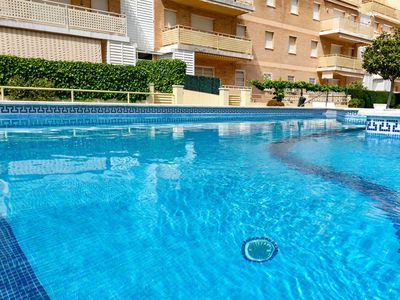 Photo for Lovely apartment with pool, WIFI, A/C, TV, washing machine and parking