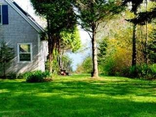 Photo for Charming cape style beachfront home on Penobscot Bay