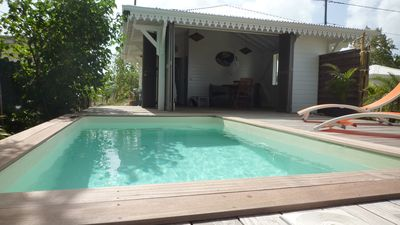 Photo for Two bungalows set in tropical gardens with private pools and sea views