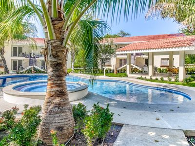 Photo for Private 12-apartment oasis w/ pool and gardens - gated community!