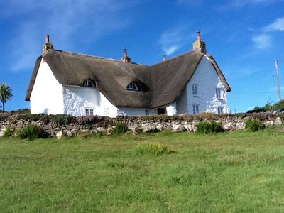 Photo for Thatched farmhouse with large garden a few minutes' walk from a stunning beach