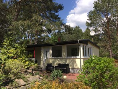 Photo for Shut down in the Waldoase - holiday home with woodburning stove in a forest and lakeside location