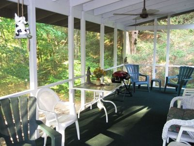 Enjoy the year round creek from this screened porch