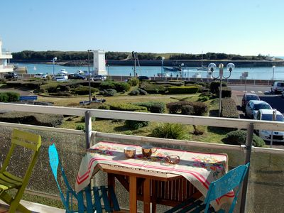Photo for Apartment with balcony, view of the harbor entrance.