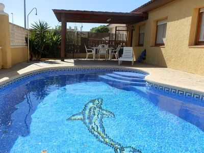Photo for CASA NAVARRO 2, Ideal house for your holidays near the sea, free wifi, air conditioning, private pool, pets allowed, dog's beach.