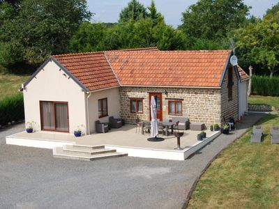 Photo for Light and airy bungalow with large terrace & heated outdoor pool