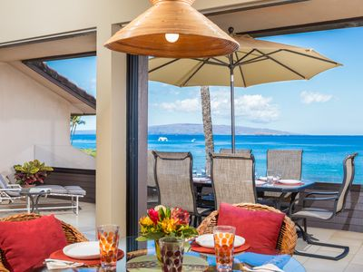 Dining room opens to lanai, allowing for spectacular ocean and beach views.
