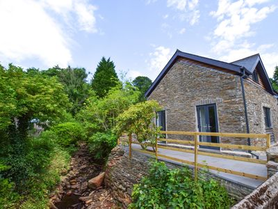 Photo for Riverside Holiday cottage stylishly restored and fully equipped for a perfect family break or get-to