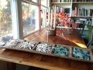 Large old barnwood table, antique metal chairs for dining, working and playing.