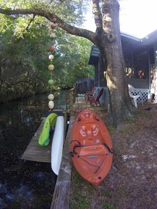 Two double, one single kayak on canal that leads to open waters of the Halls Riv