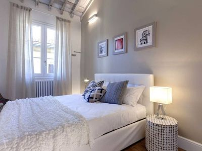 Finely renovated and modernly furnished apartment located on the third floor of a historic building.