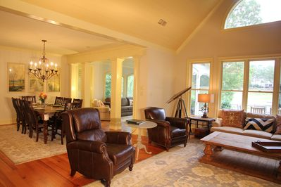 Open concept view of den, dining and sunroom