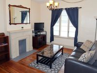Clean older townhouse living room. bathroom and kitchen downstairs 3 bedrooms upstairs.